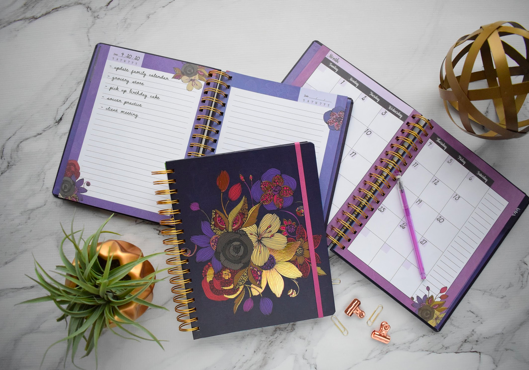 An open planner and notepad